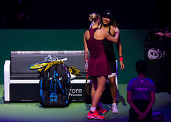 October 26, 2018 - Kallang, SINGAPORE - Naomi Osaka of Japan embraces Kiki Bertens after being forced to retire due to injury at the 2018 WTA Finals tennis tournament (Credit Image: © AFP7 via ZUMA Wire)