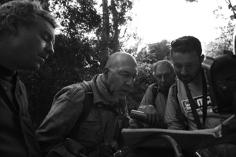 Steve (L), Billy, Noel and Digby take a map-reading break during the motorbike trip along the Ho Chi Minh Trail, Laos.
