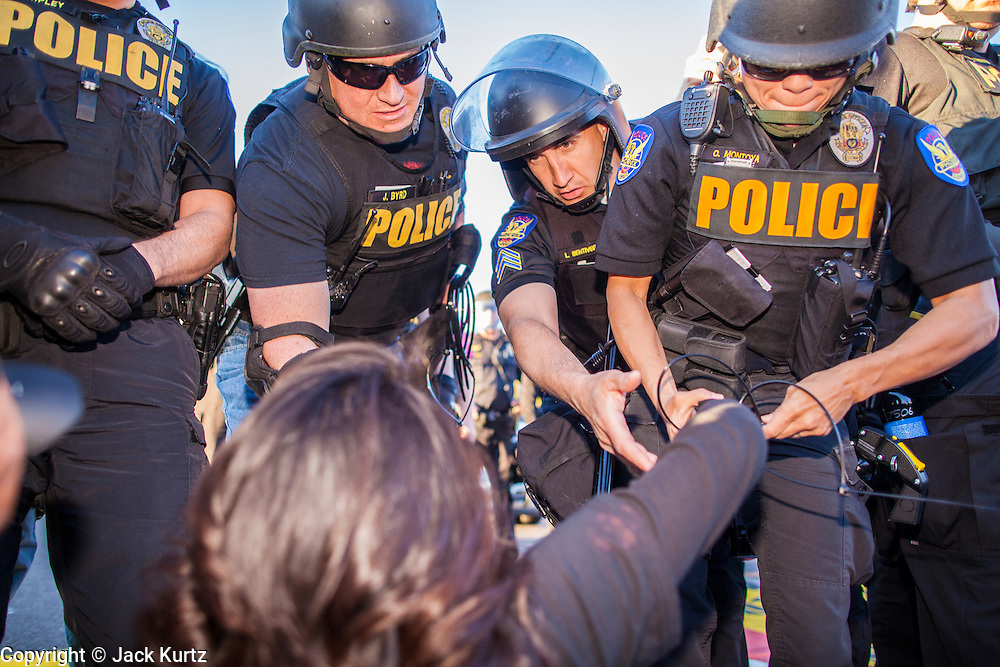 20 MARCH 2012 - PHOENIX, AZ: Phoenix police move to arrest students during a student protest in support of the DREAM Act on 75th Ave in front of Trevor G. Browne High School Tuesday.  PHOTO BY JACK KURTZ