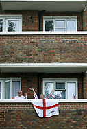 Residents of Jubilee Street in Stepney Green, east London watching a street party to celebrate Queen Elizabeth II's Golden Jubilee from a balcony of their apartment. Celebrations took place across the United Kingdom with the centrepiece a parade and fireworks at Buckingham Palace, the Queen's London residency. Queen Elizabeth ascended to the British throne in 1952 upon the death of her father, King George VI.