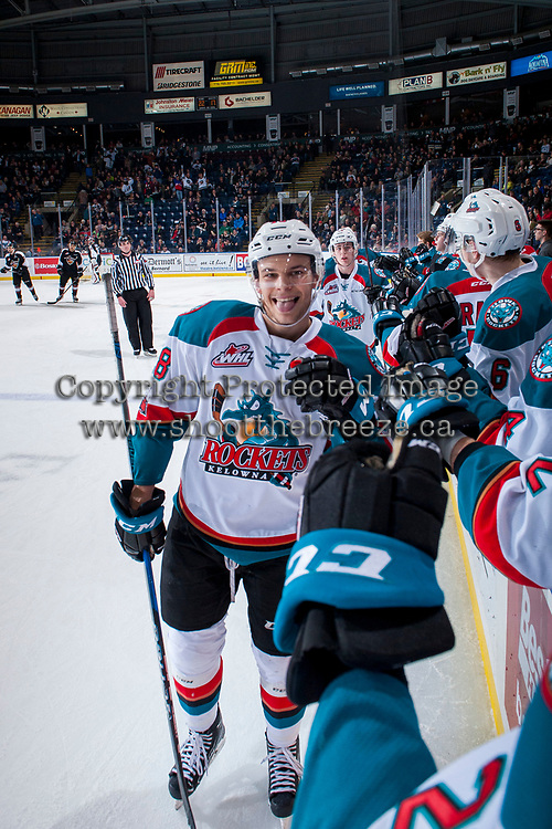 KELOWNA, CANADA - MARCH 7:  Carsen Twarynski #18 of the Kelowna Rockets skates past the bench to celebrate a goal giving his signature emoticon face during second period against the Vancouver Giants on March 7, 2018 at Prospera Place in Kelowna, British Columbia, Canada.  (Photo by Marissa Baecker/Shoot the Breeze)  *** Local Caption ***