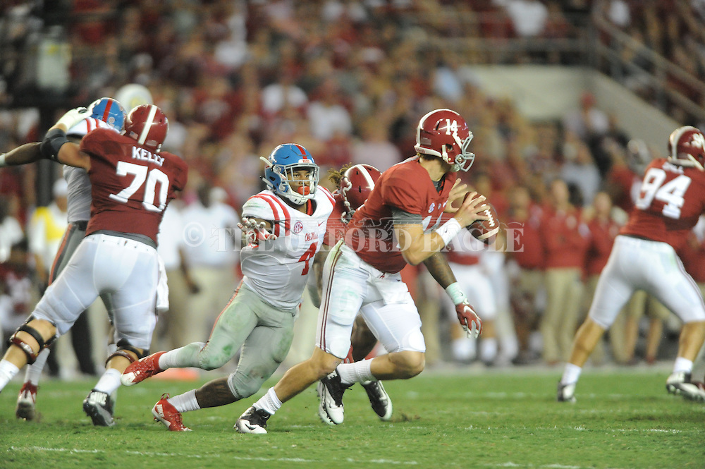 Ole Miss Rebels linebacker Denzel Nkemdiche (4) rushes Alabama Crimson Tide quarterback Jake Coker (14) at Bryant-Denny Stadium in Tuscaloosa, Ala. on Saturday, September 19, 2015. Ole Miss won 43-37.