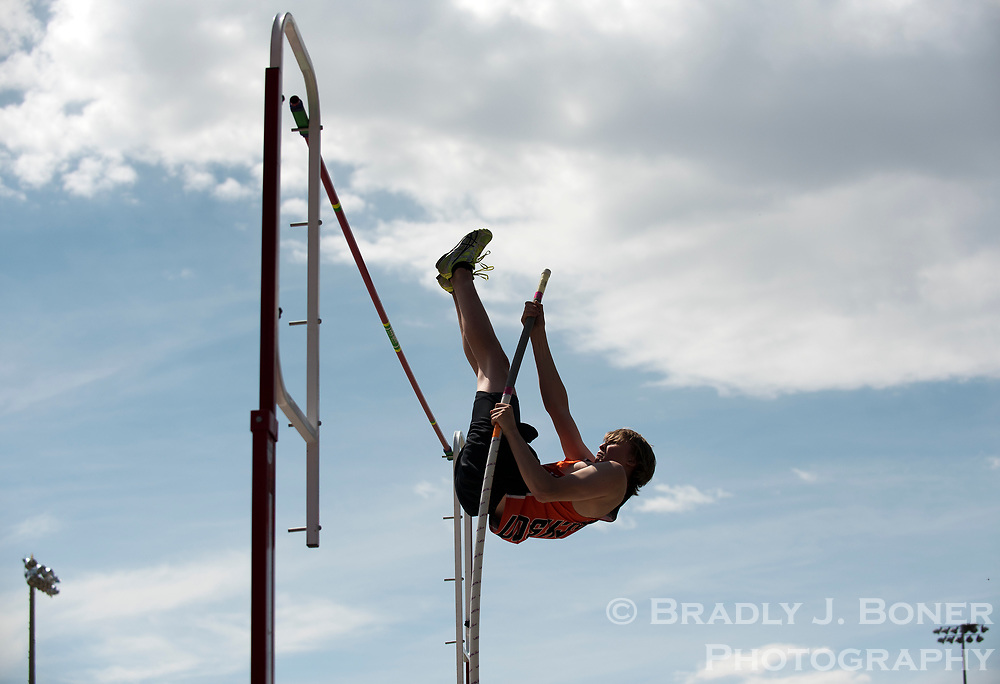 Jackson Hole High School sophomore Madden Hart rockets skyward during while competing in the pole vault Saturday during the school's home track meet.