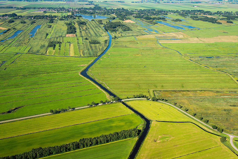 Nederland, Overijssel, Giethoorn, 27-08-2013;<br /> Weide en voormalig veengebied tussen Giethoorn en Steenwijk. Giethoorn aan de horizon.<br /> Meadow and or form peat lands (East Netherlands).<br /> luchtfoto (toeslag op standaard tarieven);<br /> aerial photo (additional fee required);<br /> copyright foto/photo Siebe Swart.