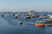 Fishing boats moored in Guanabara Bay in the Urca neighborhood in Rio de Janeiro, Brazil.