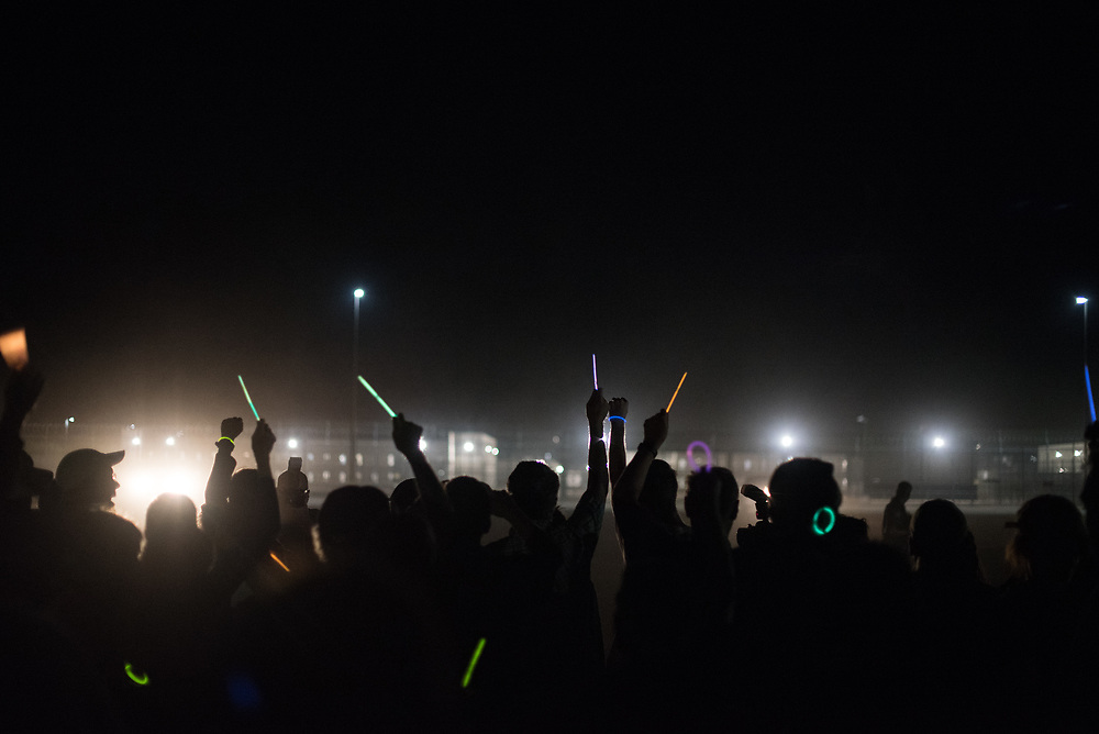 Demonstrators gather outside the Eloy Detention Center in Eloy, Arizona for a vigil held for detained immigrants on November 10, 2017. This demonstration was part of a weekend of actions called the SOA Watch Border Encuentro held along the Arizona, U.S.-Sonora, Mexico border region focused on immigrant rights, the demilitarization of the border, and other human rights issues.