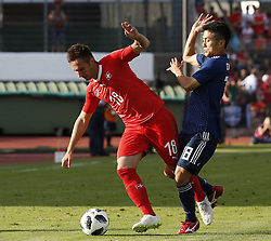 LUGANO, June 9, 2018  Switzerland's Mario Gavranovic (L) vies with Japan's Ryota Oshima during the international friendly match at the Stadium Cornaredo in Lugano, southern Switzerland June 8, 2018. Switzerland won 2-0. (Credit Image: © Ruben Sprich/Xinhua via ZUMA Wire)