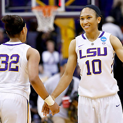 Mar 24, 2013; Baton Rouge, LA, USA; LSU Tigers guard Adrienne Webb (10) and guard Danielle Ballard (32) celebrate after a win over the against the Green Bay Phoenix in the first round of the 2013 NCAA womens basketball tournament at the Pete Maravich Assembly Center.  LSU defeated Green Bay 75-71. Mandatory Credit: Derick E. Hingle-USA TODAY Sports
