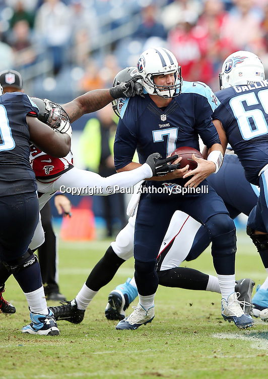 Tennessee Titans quarterback Zach Mettenberger (7) gets hit and flushed out of the pocket during the 2015 week 7 regular season NFL football game against the Atlanta Falcons on Sunday, Oct. 25, 2015 in Nashville, Tenn. The Falcons won the game 10-7. (©Paul Anthony Spinelli)