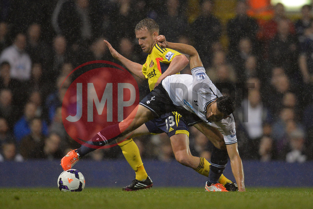 Sunderland's midfielder Lee Cattermole and Tottenham's midfielder Nacer Chadli compete for the ball  - Photo mandatory by-line: Mitchell Gunn/JMP - Tel: Mobile: 07966 386802 07/04/2014 - SPORT - FOOTBALL - White Hart Lane - London - Tottenham Hotspur v Sunderland - Premier League