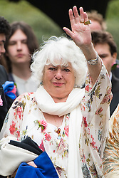 © Licensed to London News Pictures. 18/04/2016. Shirley, UK.  Wife Anne arrives at The funeral of comedian, actor, writer Ronnie Corbett, held at St John the Evangelist Church in Shirley near Croydon. Corbett, who was most famous for his comedy sketch show  The Two Ronnies, performed with the late Ronnie Barker, died at the age of 85. Photo credit: Ben Cawthra/LNP
