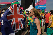 Goalkeeper Toni Cronk and fellow-members of the Australian Women's Hockey team emerge after their 2-0 victory over China to secure an overall 5th place. Played in the Riverbank Arena in the Olympic Park during the London 2012 Olympics the girls meet their loyal fans and many friends outside the stadium to celebrate their win. Toni Maree Cronk (1980) is a field hockey goalkeeper from Australia, who made her debut for the Australian women's national team in October 2001 in the test series against New Zealand in Melbourne. Nicknamed Cronky she was a member of the Hockeyroos at the 2004 Summer Olympics in Athens, Greece, where the team ended up in fifth place in the overall-rankings.