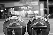 A pair of parking meters in downtown Missoula, Montana at night. Black and white image. Missoula Photographer, Missoula Photographers, Montana Pictures, Montana Photos, Photos of Montana