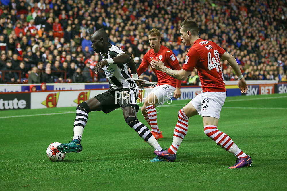 Newcastle United midfielder Mohamed Diame (15)  closed down by Barnsley midfielder, on loan from Liverpool, Ryan Kent (40)  during the EFL Sky Bet Championship match between Barnsley and Newcastle United at Oakwell, Barnsley, England on 18 October 2016. Photo by Simon Davies.