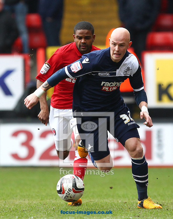 Picture by John  Rainford/Focus Images Ltd +44 7506 538356.16/03/2013.Bradley Pritchard of Charlton Athletic tracks Richard Chaplow of Millwall during the npower Championship match at The Valley, London.