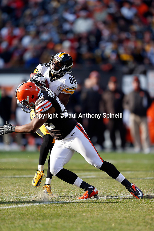 Pittsburgh Steelers wide receiver Emmanuel Sanders (88) catches a second quarter pass and gets tackled by Cleveland Browns linebacker Emmanuel Acho (59) during the NFL week 12 football game against the Cleveland Browns on Sunday, Nov. 25, 2012 in Cleveland. The Browns won the game 20-14. ©Paul Anthony Spinelli