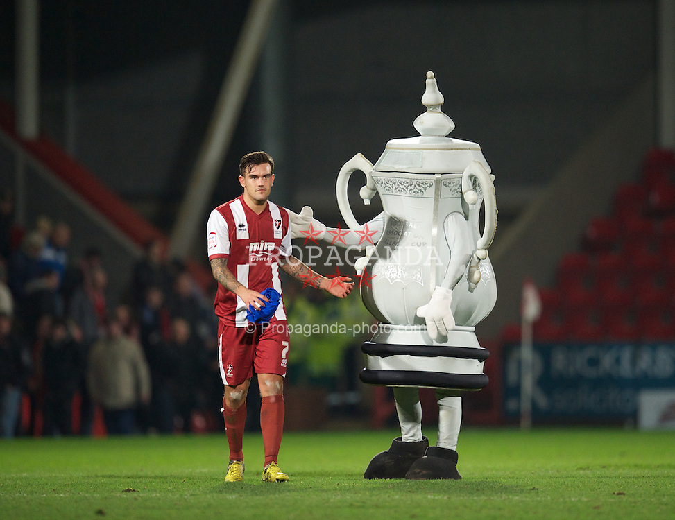 CHELTENHAM, ENGLAND - Monday, January 7, 2013: Cheltenham Town's Marlon Pack looks dejected as he is consoled by the FA Cup mascot after losing to Everton during the FA Cup 3rd Round match at Whaddon Road. (Pic by David Rawcliffe/Propaganda)