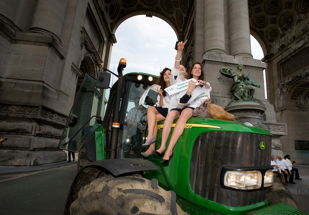 BRUSSELS - BELGIUM - 18 JUNE 2008 -- Hundreds of Farmers from belgian Wallonia went with their tractors to brussels to protest against high fuel cost the day before an EU summit to push leaders for help coping with skyrocketing fuel prices. Here a tractor with farm girls on the helmet.  Photo: Erik Luntang