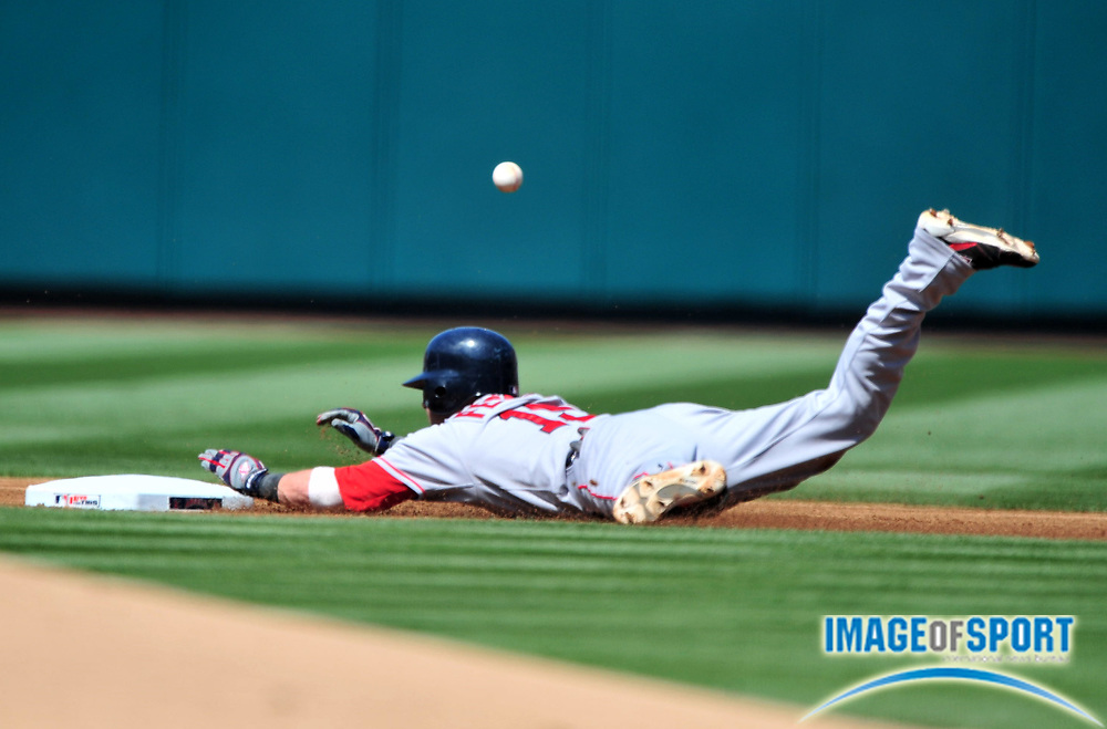 Jul 20, 2008; Los Angeles, CA, USA; Boston Red Sox second baseman Dustin Pedroia (15) slides into second base on a double against the Los Angeles Angels at Angel Stadium. Mandatory Credit: Kirby Lee/Image of Sport-US PRESSWIRE
