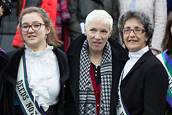 "© Licensed to London News Pictures. 08/03/2015. London, UK. Laura Pankhurst, Annie Lennox and Helen Pankhurst at the ""Walk In Her Shoes"" event to mark International Women's Day at The Scoop amphitheatre on the south bank in London. Photo credit : Vickie Flores/LNP"