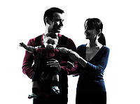 portrait parents with baby in silhouettes on white background