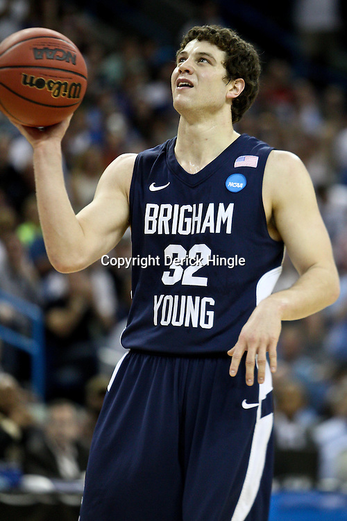 Mar 24, 2011; New Orleans, LA; Brigham Young Cougars guard Jimmer Fredette (32) against the Florida Gators during the first half of the semifinals of the southeast regional of the 2011 NCAA men's basketball tournament at New Orleans Arena.  Mandatory Credit: Derick E. Hingle