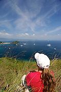 Woman contemplating the bay from Cerro La Cruz summit. Taboga island, Panama province, Panama, Central America.