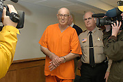 Reputed Ku Klux Klan member Edgar Ray Killen,left , is lead into court by Neshoba county sheriff larry Meyers Friday, Jan. 7, 2005,  as he was arraigned on murder charges in the slayings of three civil rights workers more than 40 years ago, at the Neshoba County Courthouse in Philadelphia, Miss.(photo/Suzi Altman)
