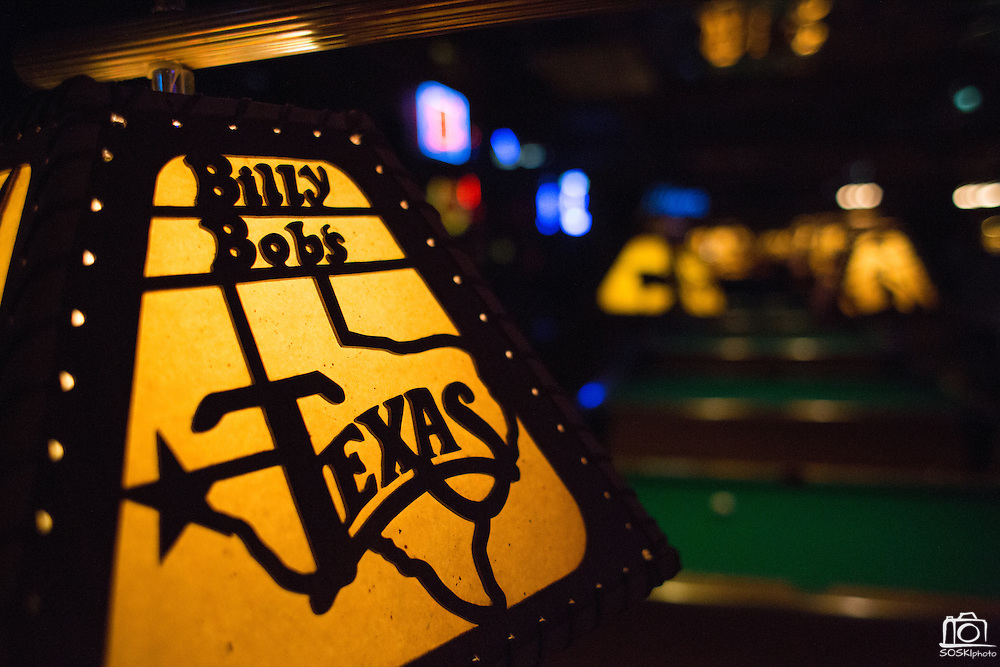 Custom light shades hang over pool tables at Billy Bob's Texas in Fort Worth, Texas on December 13, 2012.  (Stan Olszewski/The Dallas Morning News)