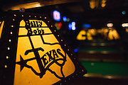 Custom light shades hang over pool tables at Billy Bob's Texas in Fort Worth, Texas on December 13, 2012.  (Stan Olszewski/The Dallas Morning News)
