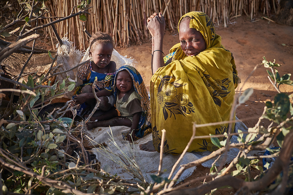 Mother Isam prepares breakfast for her children in a camp of internally displaced people by the side of the road on the highway outside of Diffa, Niger on February 14, 2016. Caritas undertook a distribution of two blankets per family in January, 2016. Most of the displaced people are from the town of Chilori, Niger on the border with Nigeria and fled when the village was attacked by Boko Haram.