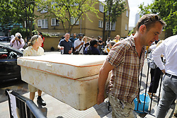 © Licensed to London News Pictures. 14/06/2017. London, UK. People bring supplies to a nearby church as the Grenfell Tower fire is still not under control 14 hours after the fire broke in west London on 14 June 2017. Photo credit: Tolga Akmen/LNP