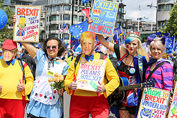 "© Licensed to London News Pictures. 20/07/2019. London, UK.  A protester wearing Conservative Party leadership contender BORIS JOHNSON (C) face mask as Pro EU demonstrators take part in the ""No to Boris. Yes to Europe"" march in central London. Photo credit: Dinendra Haria/LNP"