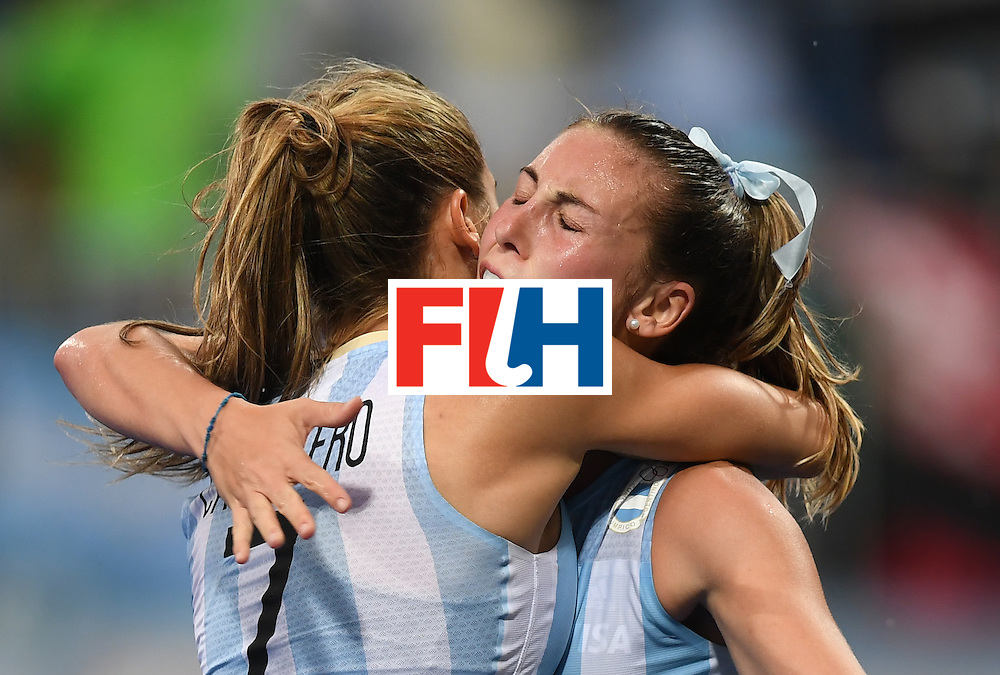 Argentina's Florencia Habif (R) celebrates scoring a goal with teammates during the women's field hockey Britain vs Argentina match of the Rio 2016 Olympics Games at the Olympic Hockey Centre in Rio de Janeiro on August, 10 2016. / AFP / MANAN VATSYAYANA        (Photo credit should read MANAN VATSYAYANA/AFP/Getty Images)