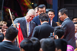 Chinatown, London, July 25thy 2016. His Royal Highness Prince Andrew The Duke of York is the Guest of Honour as a new Chinese gate on Wardour Street is inaugurated. PICTURED: HRH Prince Andrew The Duke Of York unveils a plaque commemorating the gate's inauguration.