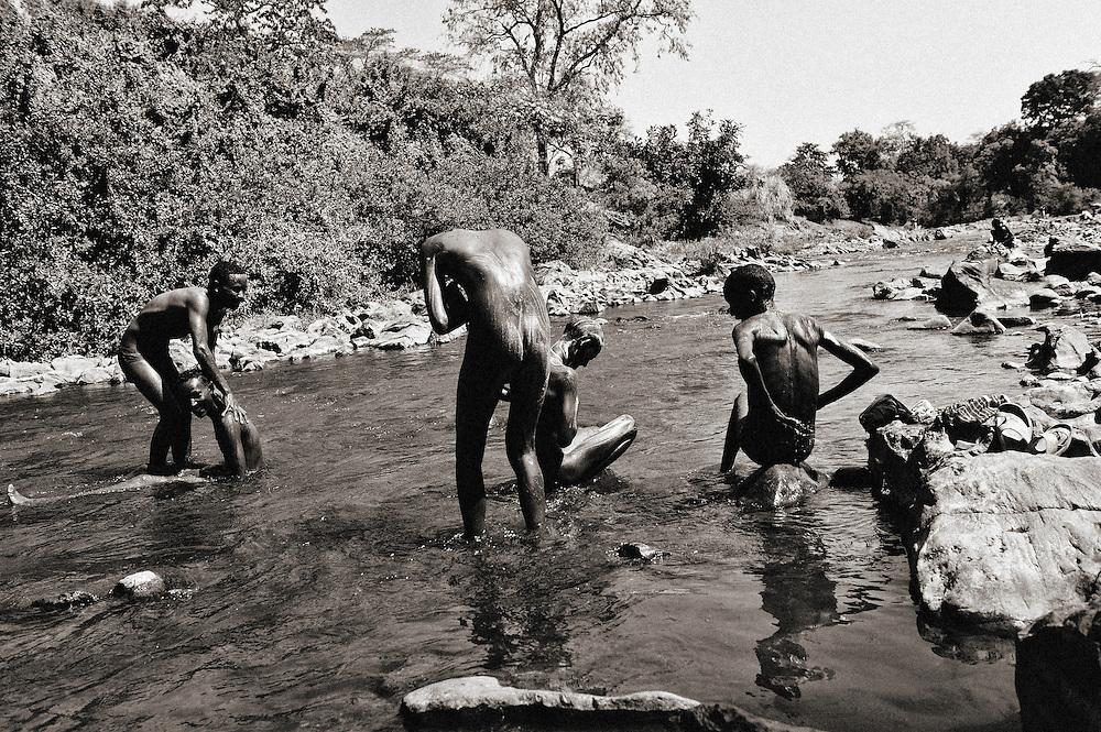 Chagne, Chagni ,Gilgel Beles, Ethiopia, Gilgel Beles Gumuz, Gilgel, Blese, valley, Africa, Ethiopia, Sudan border, boy, boys, washing Beles