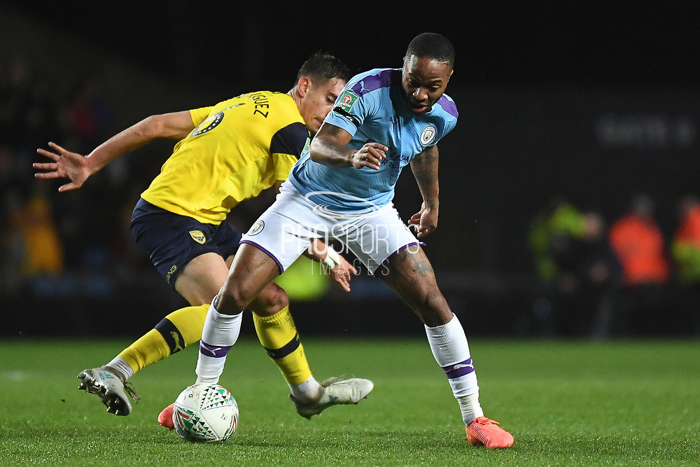 Manchester City forward Raheem Sterling (7) battles for possession  during the EFL Cup match between Oxford United and Manchester City at the Kassam Stadium, Oxford, England on 18 December 2019.