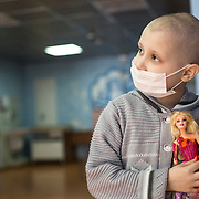 A girls who sufferes from cancer at the National Cancer Institute in Kiev, Ukraine