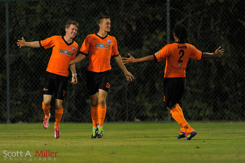 Dayton Dutch Lions forward Brandon Swartzendruber (24) celebrates his goal with forward Eric Kissinger (11) and  defender Shane Smith (2) during a USL-Pro soccer game at the Plant City Stadium in Plant City, Florida April 26, 2013. Dayton won 1-0....©2013 Scott A. Miller