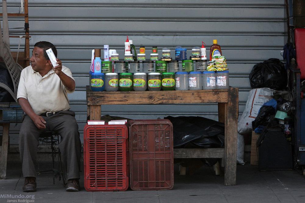 Street vendor in downtown San Salvador awaits customers.