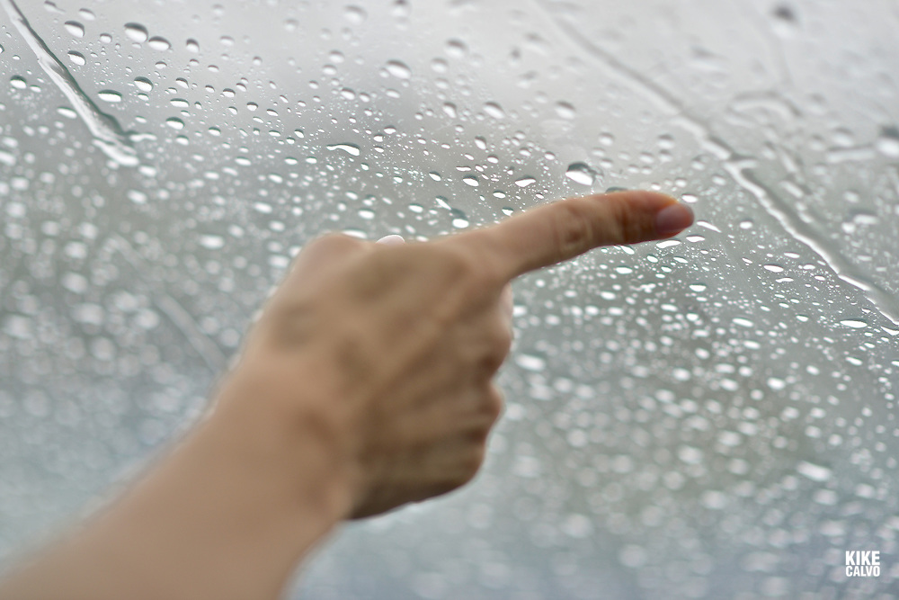 Woman´s hands touching rain drops with her finger, watching them from the inside of a vehicle.   May 29, 2014. (Kike Calvo via AP Images)
