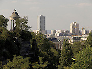 a park with a classic style lookout looking out over Paris