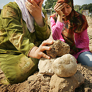 29th July 2006&amp;#xD;&amp;#xA;Tyre, Lebanon&amp;#xD;&amp;#xA;Mass Burial.&amp;#xD;&amp;#xA;&amp;#xD;&amp;#xA;Amina Baalbeki (left to right) and her daughter Nazeera Kassab, grieve at the site of a mass burial of more than 30 people killed by Israeli bombardment. Aminas mother Nazerra Birro was amoungst those interned.<br />