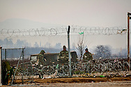 Macedonia's military build a second fence, in Idomeni, the Greek-Macedonian border.<br /> . 9 Febraury 2016<br /> Hundreds of refugees arrive at Idomeni and cross the border between Greece and Macedonian on their journey to North Europe.