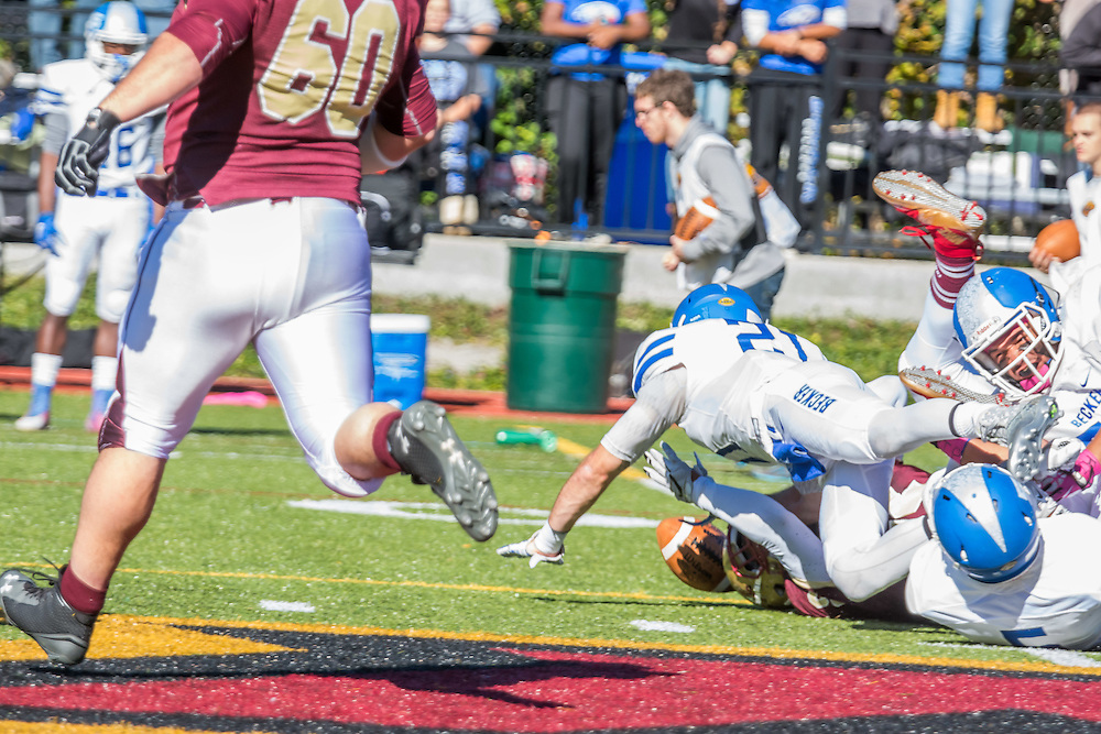 Photos of the football game versus Becker College during the Fall 2015 Homecoming Celebration including a march down by the Corps of Cadets.