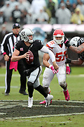 Oakland Raiders quarterback Derek Carr (4) looks to pass as he gets flushed out of the pocket by Kansas City Chiefs outside linebacker Frank Zombo (51) during the 2016 NFL week 6 regular season football game against the Kansas City Chiefs on Sunday, Oct. 16, 2016 in Oakland, Calif. The Chiefs won the game 26-10. (©Paul Anthony Spinelli)