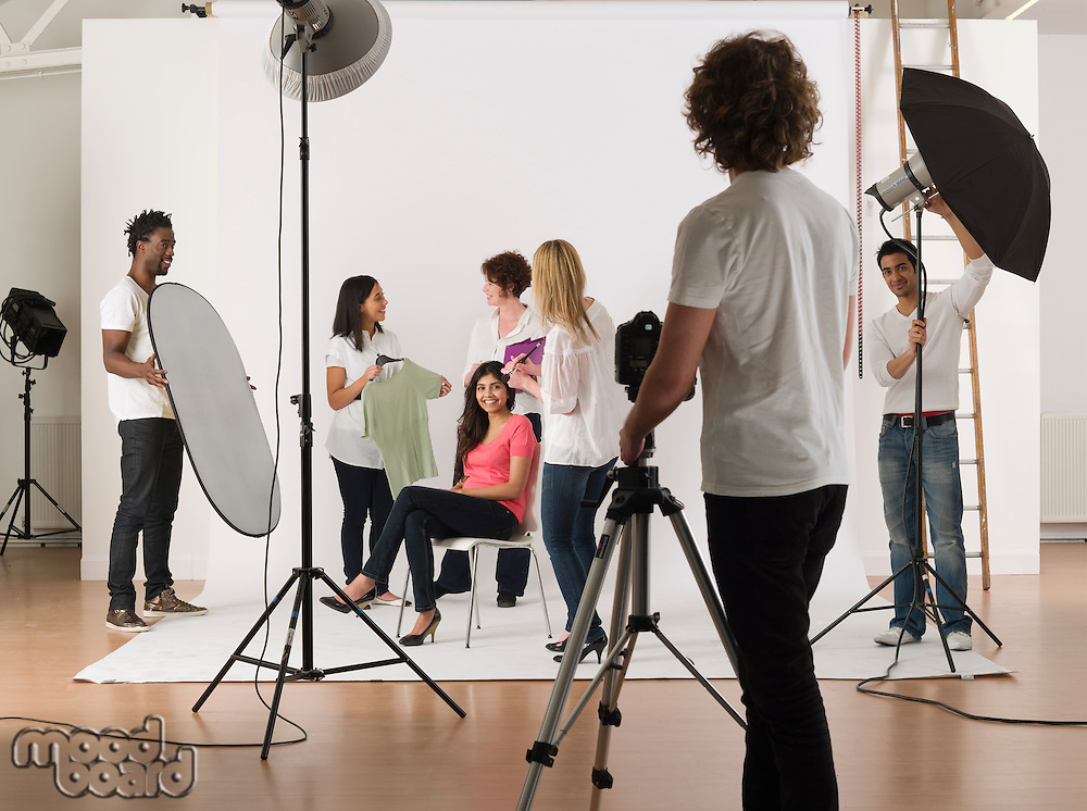 Group of young people in studio during preparing photo session