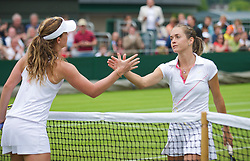 LONDON, ENGLAND - Monday, June 22, 2009: Michelle Larcher De Brito (POR) shakes hands with Klara Zakopalova (CZE) after her Ladies' Singles 1st Round victory during day one of the Wimbledon Lawn Tennis Championships at the All England Lawn Tennis and Croquet Club. (Pic by David Rawcliffe/Propaganda)