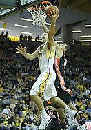 December 04 2010: Iowa Hawkeyes guard Eric May (25) puts up a shot by Idaho State Bengals forward/center Abner Moreira (21) during the second half of their NCAA basketball game at Carver-Hawkeye Arena in Iowa City, Iowa on December 4, 2010. Iowa won 70-53.