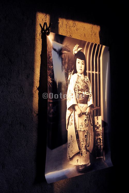 vintage photo of Japanese girl on wall with the light of the sun through a window